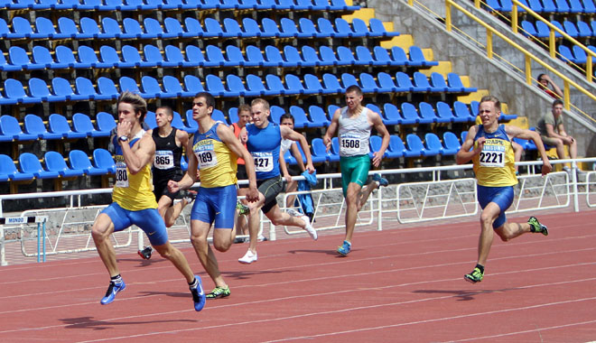 Unidentified men at the finish of the 200 meters race on the Ukrainian Track & Field Championships on June 01, 2012 in Yalta, Ukraine.