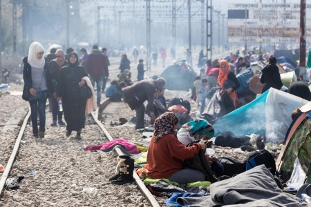 Idomeni, Greece - March 8, 2016: Thousands of immigrants are in a wait at the border between Greece and FYROM waiting to cross the borders to FYR of Macedonia.