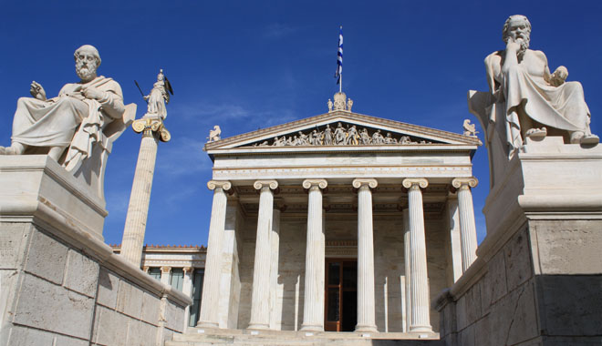 Neoclassical Academy of Athens in Greece showing main building and statues of ancient Greek philosophers Plato (left), Socrates (right) and goddess Pallas Athena (behind Plato). The Academy of Athens is the highest research establishment in the country and one of the major landmarks of the city.
