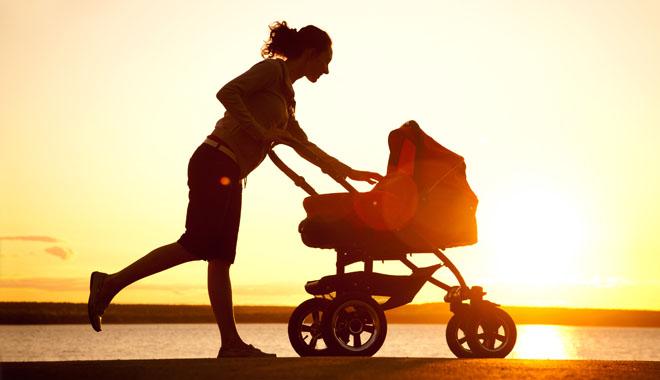 Silhouette of young mother enjoying motherhood